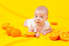 Babe lies in oranges Stock Image