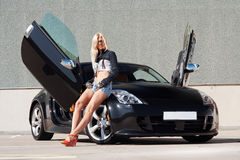 Babe near super car Royalty Free Stock Images