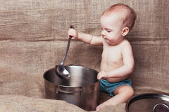 Babe with a pan and ladle royalty free stock image
