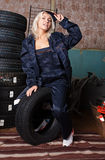 Babe with tires. Royalty Free Stock Images