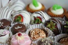 babeczki ustawiający cukierki Zdjęcia Stock