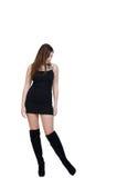 Babeface het vrouwelijke stellen in de studio gekleed in zwarte kleding Royalty-vrije Stock Afbeeldingen