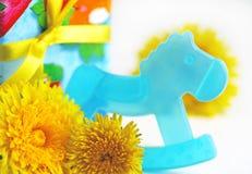 Babes Birthday. Holiday. Birthday. New-born. Childhood. Hobby-horse Royalty Free Stock Images