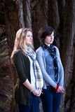 Babes in the Woods. Two attractive young women (one in her teens, one in her twenties) in a forest Royalty Free Stock Photo