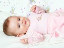 Babie's portrait. Adorable girl setting on sofa Stock Photography