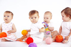 Babies. Group of babies sitting on white studio background Stock Images