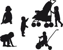 Babies. Black silhouettes of playing babies Stock Photos