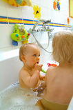 Babies. Happies children in a bathroom stock photography