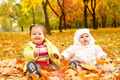 Babies in autumn park Royalty Free Stock Images
