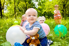 Babies with balloons Stock Photo