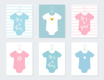 Babies Bodysuits Clothes on Hangers. Baby Announcement Cards. It's a Boy. It's a Girl. Hand Lettering Signs Stock Photo