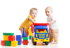 Babies boys play together Stock Images