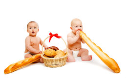 Babies and bread Royalty Free Stock Photos