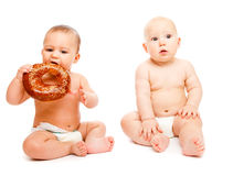 Babies with bread Royalty Free Stock Photos