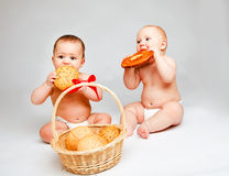 Babies with buns Royalty Free Stock Photography