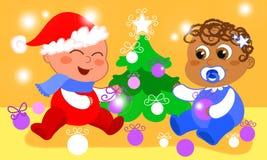 Babies and Christmas tree Stock Image
