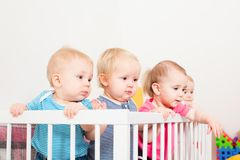 Babies in the crib Royalty Free Stock Photos
