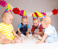 Babies with cupcakes Royalty Free Stock Photo