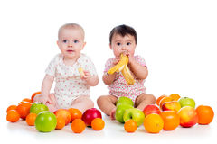Babies eating fruits Royalty Free Stock Images