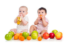Babies eating fruits Stock Image