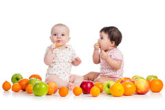 Babies eating fruits Royalty Free Stock Photo