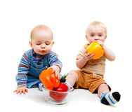Babies eating peppers Royalty Free Stock Photo