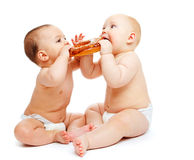 Babies eating a roll Stock Photo
