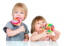 Babies eating a sticky lollipop Stock Photos