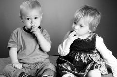 Babies eating together Royalty Free Stock Photos