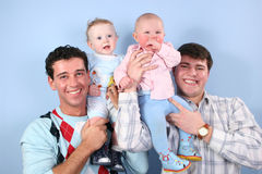 Babies on fathers shoulders Royalty Free Stock Photo