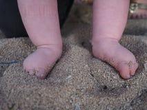 Babies feet in sand, Bali Stock Photo