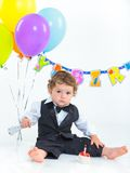 Babies' first birthday one year. Royalty Free Stock Images