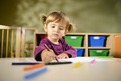 Babies and fun, child drawing at school Stock Image