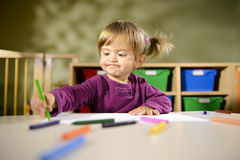 Babies and fun, child drawing at school Royalty Free Stock Photos