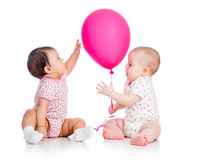 Babies girls play red ballon Stock Photos