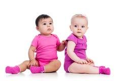 Babies girls sitting royalty free stock image