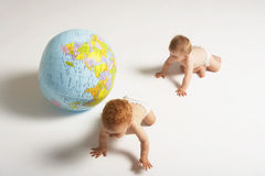 Babies And A Globe Stock Photos
