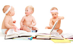 Babies group reading books Stock Images
