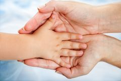 Babies Hand Resting On Mothers. Royalty Free Stock Photo