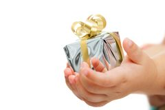 Babies hands holding small present. Stock Photos