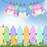 Triplets babies hanging on clothesline stock illustration