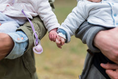 Babies holding hands Royalty Free Stock Image