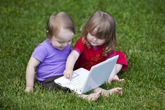 Babies & Information Technology Royalty Free Stock Image