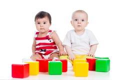 Babies or kids play block toys stock photos