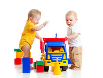 Babies kids play toys Stock Photos