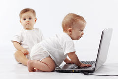Babies with laptop Royalty Free Stock Image