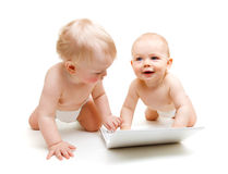 Babies with laptop. Two modern baby boys with laptop, isolated Royalty Free Stock Photography