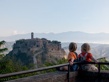 Babies looking at Civita di Bagnoregio. Italy Stock Images