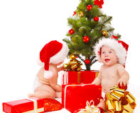 Babies looking for presents Royalty Free Stock Photos