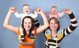 Babies on mothers shoulders